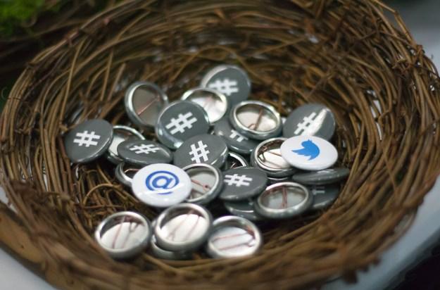 #, @ and Twitter bird buttons in a bird's nest basket