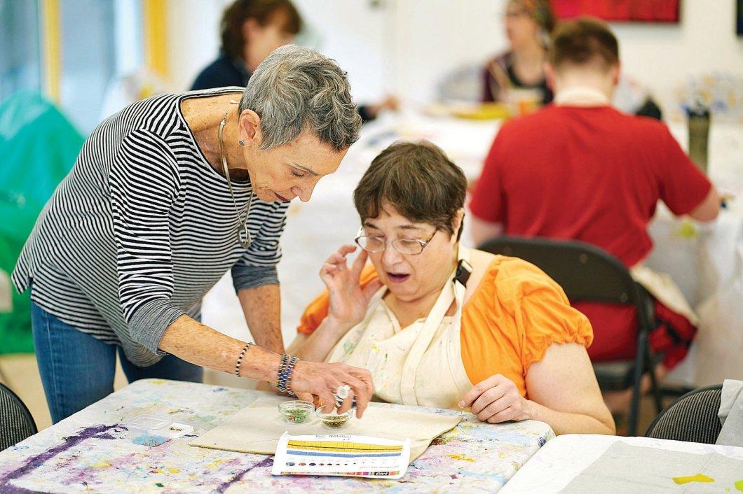Volunteer Sandy Van and CATA artist Diane Paioli of Pittsfield make a beaded bracelet in the CATA studio in Great Barrington