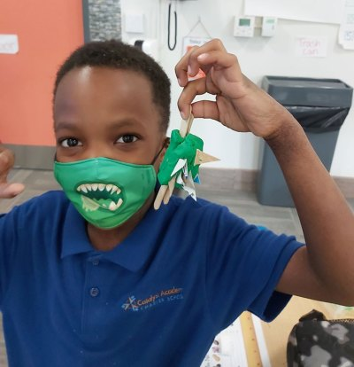 Catalyst Academy student learns about carnivores in STEM lesson