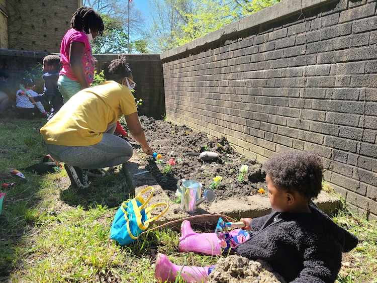 Catalyst Academy scholars planting garden