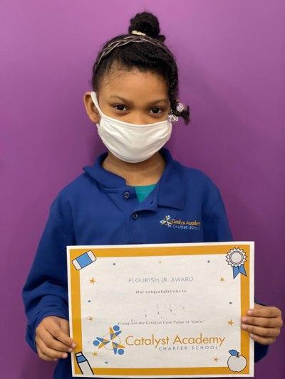 Catalyst scholar with her Flourish Award