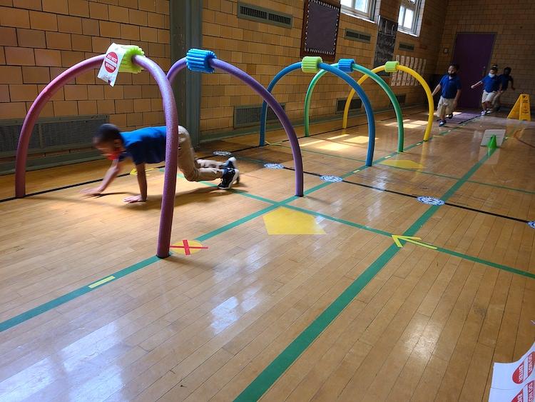 Catalyst Student Playing Hoop Run