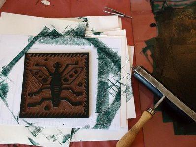 Inking Peru Bug linocut