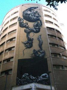 Tumbling animals street art