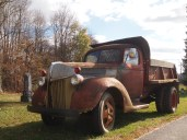 an old truck in Elmwood Cemetery