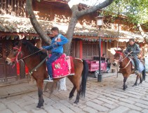 Boys on horses in Shaxi's square