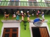 puppets dangle from balconies