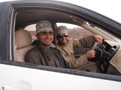 my excellent student, Badr, on the left and his unknown friend driving near Birkat al Mouz, Oman