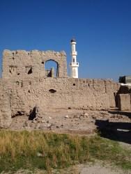 the mudbrick walls and the minaret