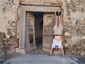 Adam does a handstand