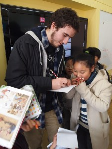 Alex signs autographs in Chojeon Elementary School, South Korea