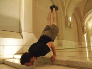 Alex does one of his gymnastic move at Al Alam Palace