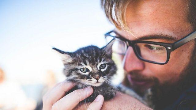 men with his cute cat