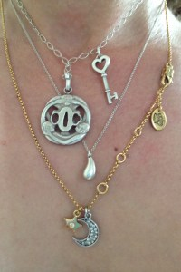 Mixing necklaces to spice up an outfit.