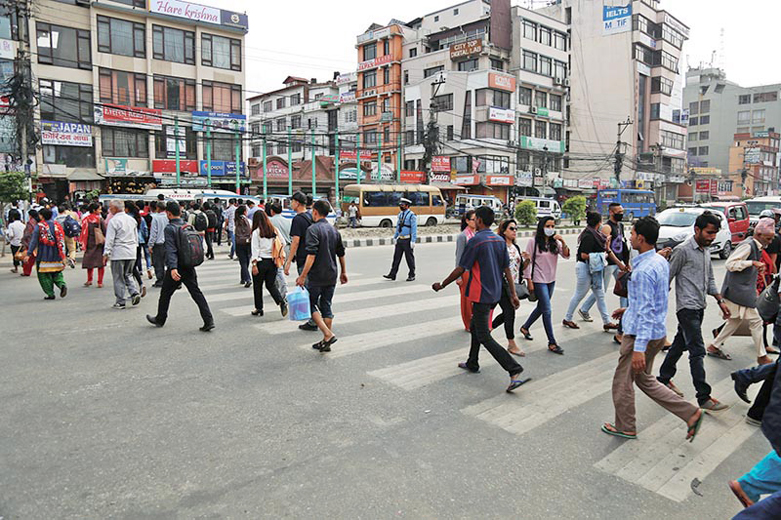 Pedestrians using a zebra crossing to cross a road in New Baneshwor, Kathmandu. Image Credit: The Himalayan Times
