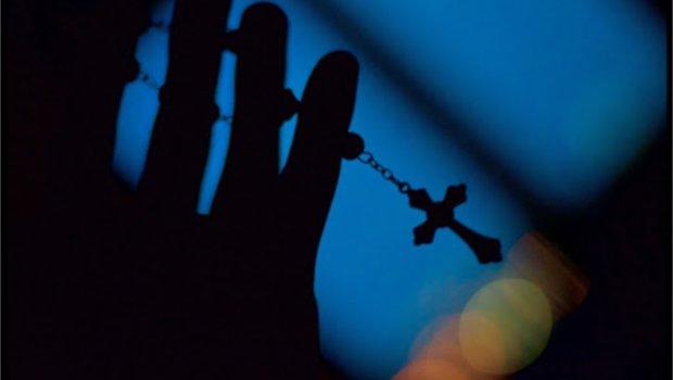 Santo Rosario en la mano