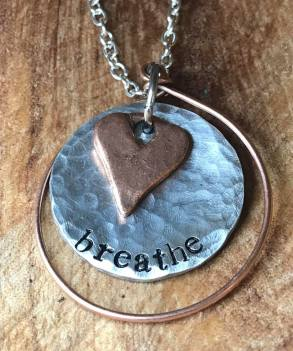 "breathe hand stamped on 1""silver pewter copper heart copper wire frame. $30"