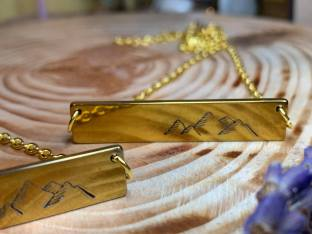 "Hand stamped mountain on gold tone horizontal bar includes 18"" goldtone chain. $28"