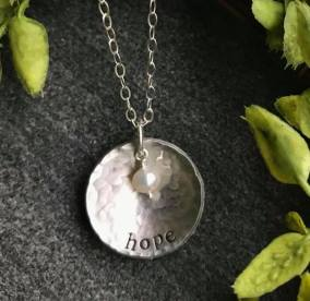 "hope hand stamped and dapped (concave) on hammered 1"" pewter disc. includes pearl 18"" silver chain. $28"