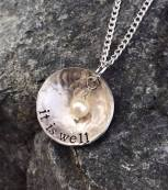 "it is well hand stamped and dapped (concave) on hammered 1"" pewter disc. includes pearl 18"" silver chain. $28"
