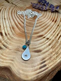 Your Letter hand stamped (lower case font )on silver tear drop includes small turquoise bead as shown or birthstone Swarovski crystal. $28