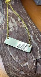 "3 trees hand stamped on horizontal gold tone rectangle includes 18"" gold tone chain. $28"