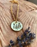 "3 trees on gold tone, silver or copper disc includes 18"" chain in silver, copper or antiqued brass. $28"