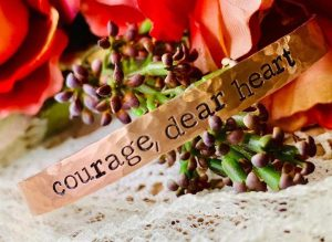 Copper handstamped bracelet with words courage, dear heart
