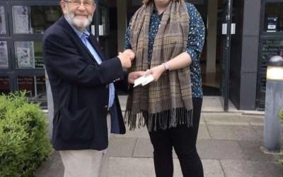 Past President of Malvern Circle presents cheque