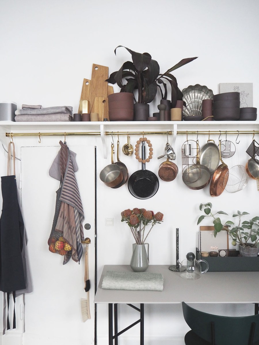 Dark green kitchen - utensil storage ideas. Proving Scandi needn't be all white: inside The Home, Copenhagen by Ferm Living. Image: Cate St Hill