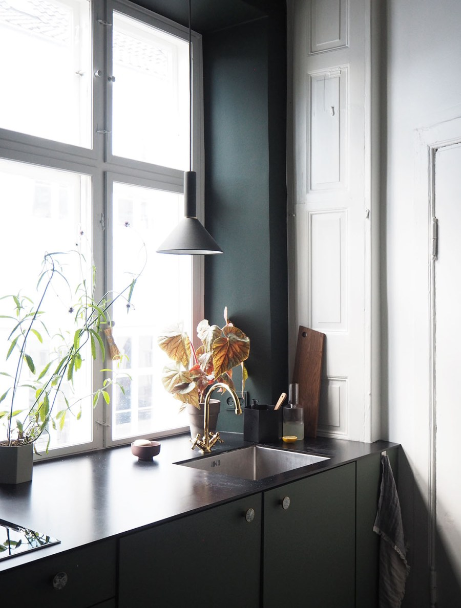 Dark green kitchen. Proving Scandi needn't be all white: inside The Home, Copenhagen by Ferm Living. Image: Cate St Hill