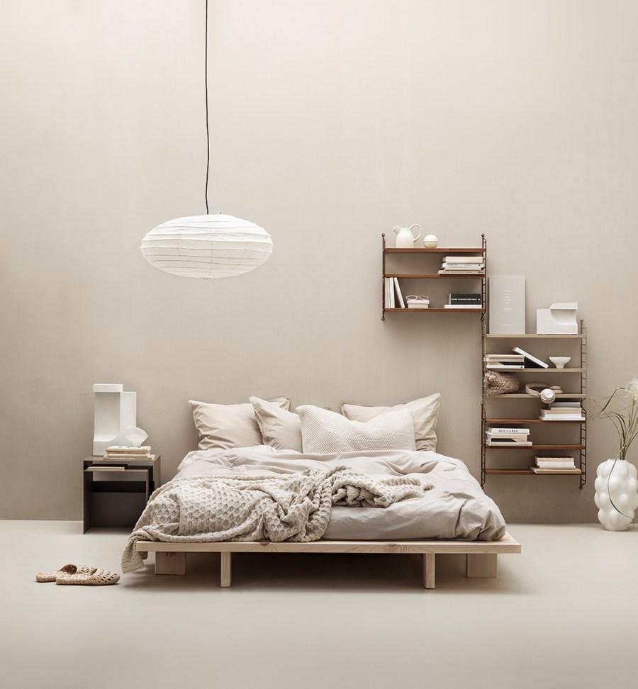 String shelving. credit: photographer: Marcus Lawett. Get the look: beige interior inspiration