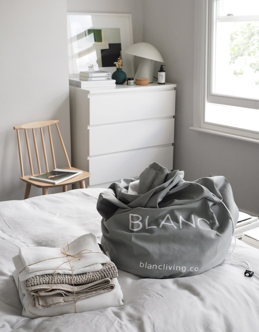 Fresh laundry - Light scandi-style bedroom with grey linen bedding - How to care for your bed linen, with eco-friendly dry cleaners BLANC London [AD]