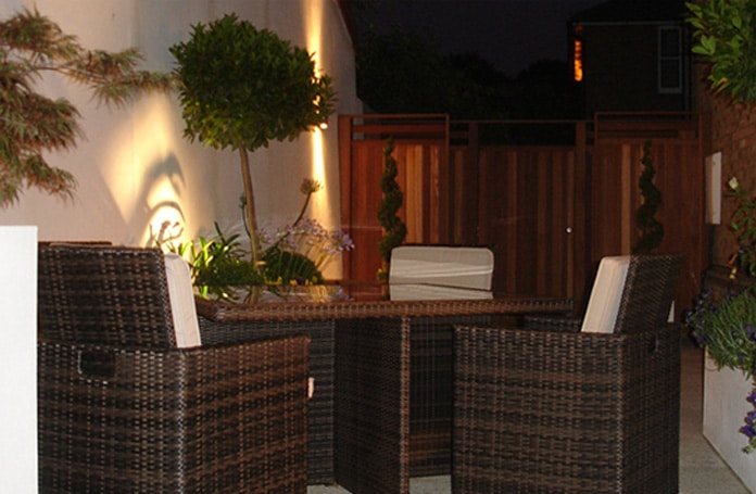 Chic courtyard garden at night