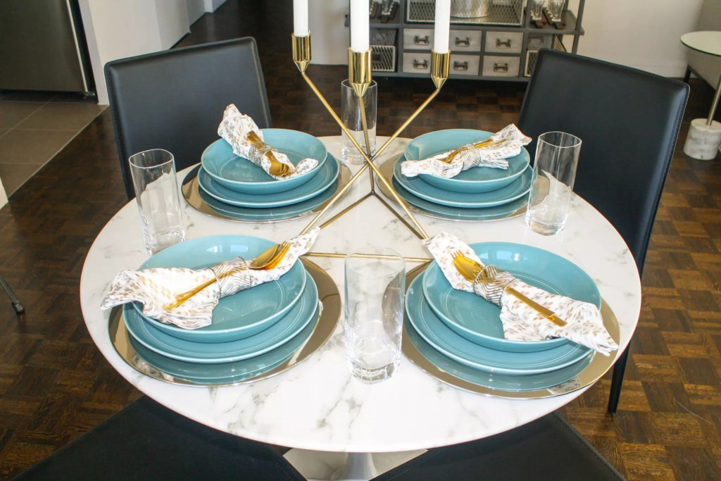 Teal and Gold Table Scape on a Round Marble Table