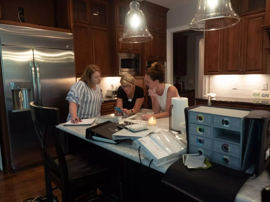 Cat and Sarah reviewing the design plan in a client's home.