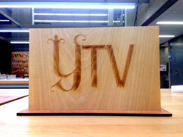A laser engraved plaque for the Yale TV production organization. The letters are V-cut raster engraved and were made by varying the power in the logo. They now use this plaque in the intro sequence and segments filmed with the anchors.