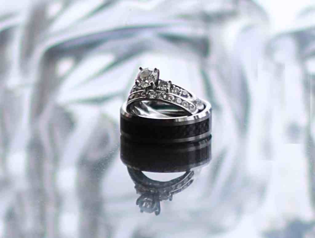 Wedding rings; brides ring standing up inside grooms ring