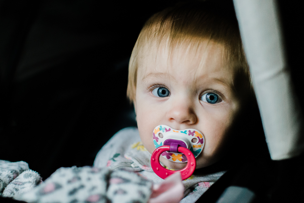 blue eye baby girl sucking on pacifier {virginia beach lifestyle newborn child couples family engagement photographer}