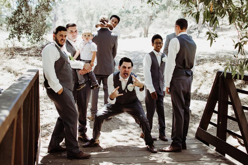 funny groomsmen on bridge {virginia beach wedding couples family newborn photographer}