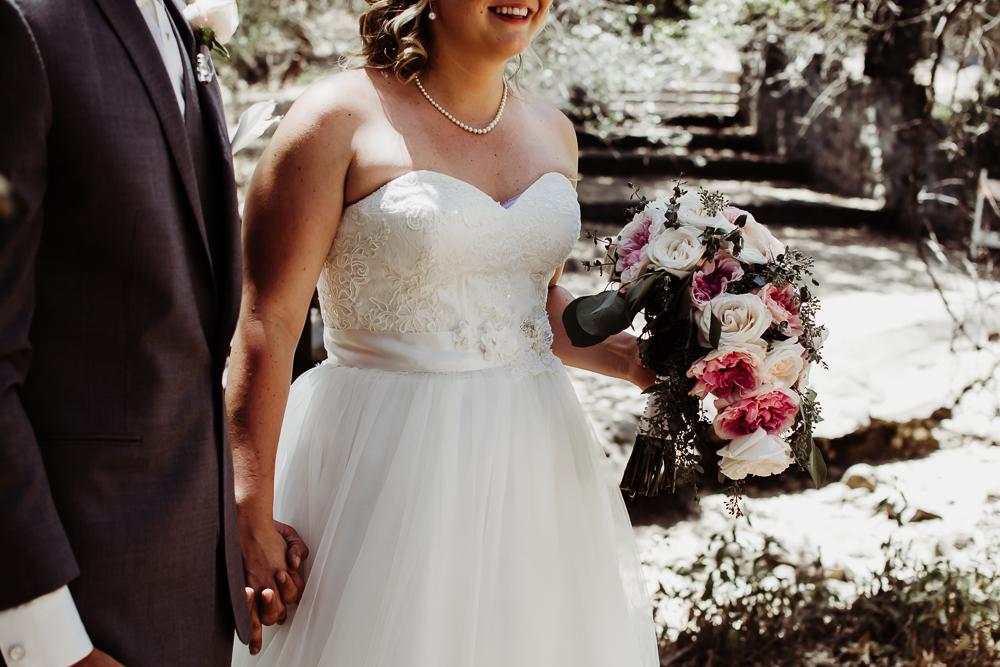 bride holding grooms hand bouquet {virginia beach wedding couples family newborn photographer}