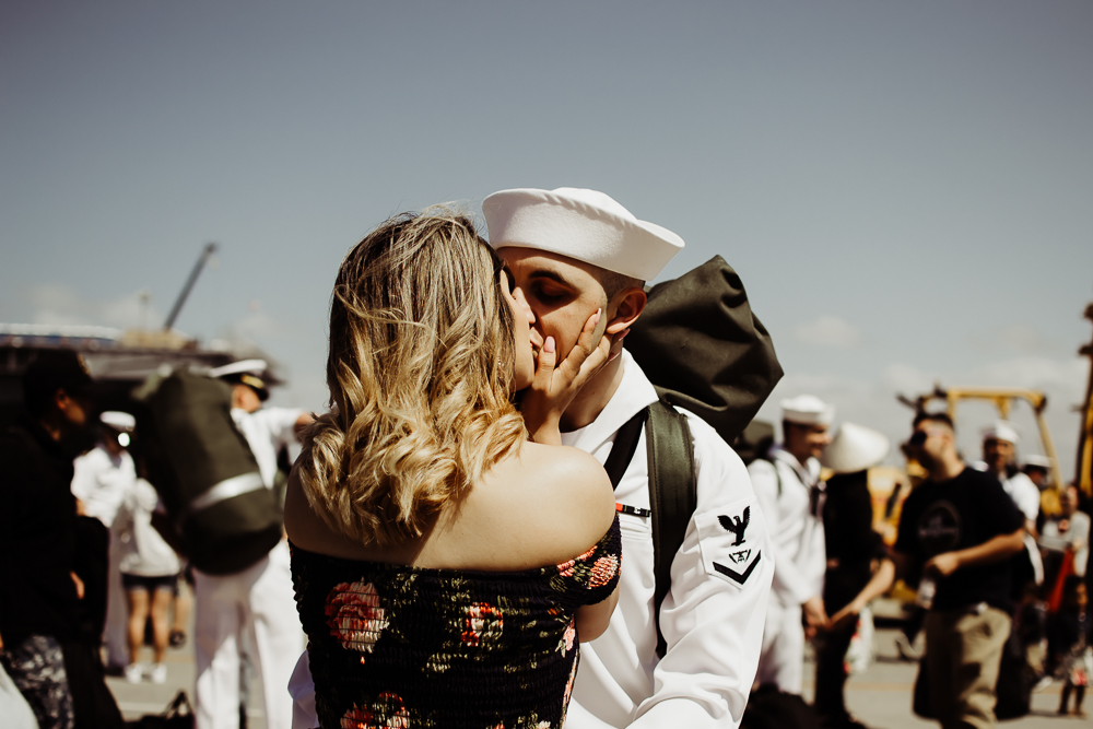 pregnant wife kissing navy husband military homecoming {virginia beach lifestyle newborn child couples family maternity engagement photographer}