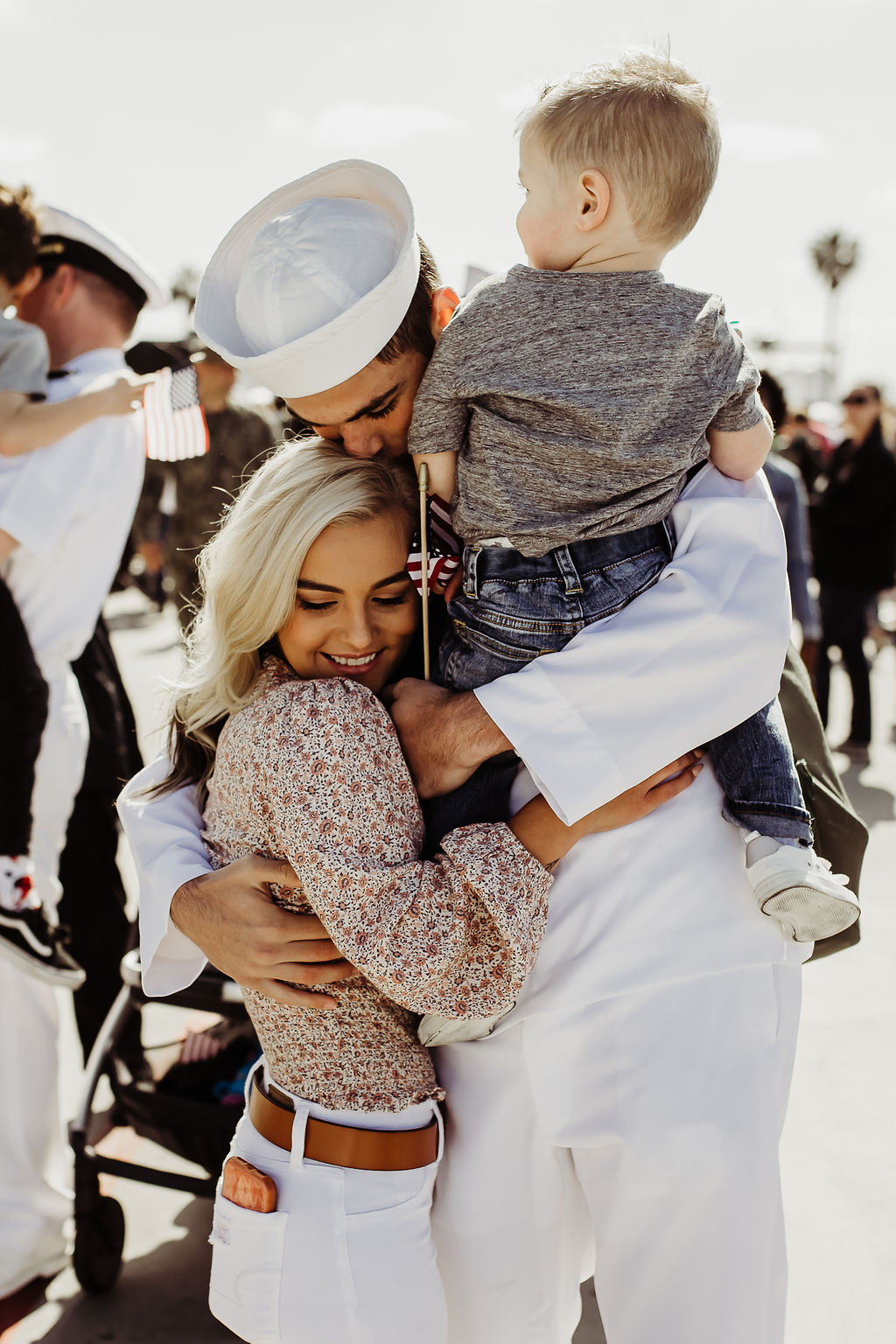 us navy ship 32nd street naval base family hugging kissing baby boy {san diego lifestyle child couples family military homecoming photographer}