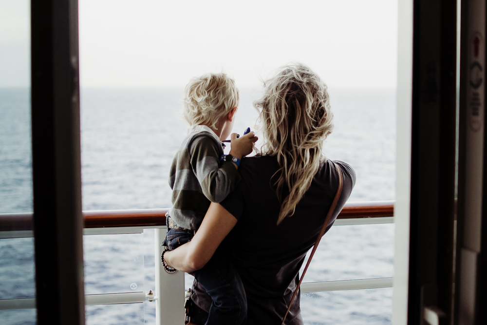 mother and son on cruise ship balcony looking at ocean disney dream {virginia beach lifestyle newborn child couples family engagement photographer}