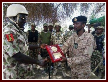 Punch newspaper photo of Col. Ali receiving award for bravery