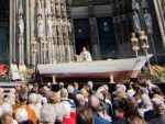 Cardinal says Mass in refugee boat next to German cathedral