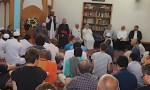 Neighbouring Muslim and Christian communities grieve together