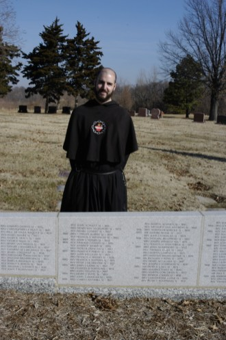 Brother Andre Marie at the tomb of Father Damen