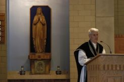 Father Lamothe peaches a short sermon relating the Gospel of the Mass to Brother Francis' life.