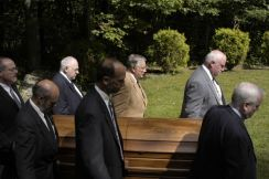 Brother being carried to his final resting place.